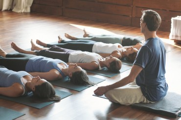 Male Yoga Teacher With Female Students